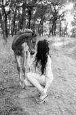 Little horse and brunette girl in the forest — 图库照片