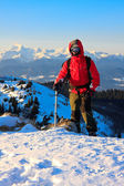 Mountaineer with ice axe — Stock Photo