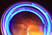Spinning wheel in a small luna park — Stock Photo