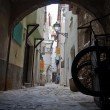 Cart in a dark and narrow alley  — Stock Photo