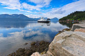 Ferry landing at pier in fjord — Stock Photo