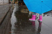 Person walking in rain down — Stock Photo