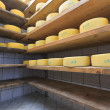Stock Photo: Cheese maturing on shelves