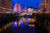 View of Ljubljanica river and tromostovje decorated with Christmas lights — Stock Photo