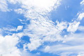Blue sky background with a tiny clouds — Stockfoto