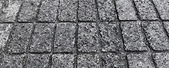 Stone paved avenue street road as background — Stock Photo