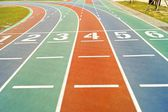 Starting lines on colorful running track — Stock Photo