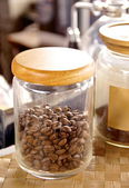 Coffee beans in the glass bottle — Stock Photo