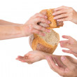 Hands grabbing for bread — Stock Photo