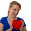 Female with a heart in her hands — Stock Photo