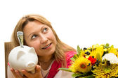 Attractive female holding a piggy bank — Stock Photo