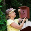 Pensioner with a nest box — Stock Photo