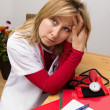 Exhausted nurse — Stockfoto #37982417