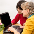 2 Women with a laptop — Stock Photo