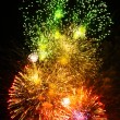 Fireworks of various colors over night sky — Stock Photo