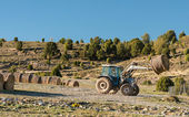Tractor Moving A Bale — Stock Photo