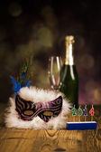Fancy dress ball, Carnival mask, glass of champagne, celebrate New Year's Eve — Stock Photo