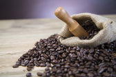 Coffee beans inscription on wooden table — Stock Photo