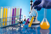 Workplace modern laboratory for molecular biology test on blue background — Stock Photo