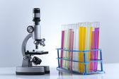 Workplace modern laboratory for molecular biology test on blue background — Foto de Stock