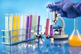 Workplace modern laboratory for molecular biology test on blue background — Stok fotoğraf