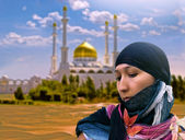 Eastern woman against mosque. Collage. — Stock Photo