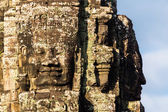 Stone head on towers of Bayon temple — Stock Photo