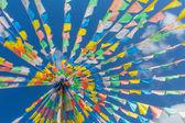 Buddhist tibetan prayer flags waving — Stock Photo
