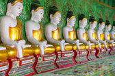 Buddhas and wall in temple — Foto de Stock