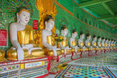 Buddhas and wall in temple — Stock Photo