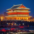 The illuminated ancient Drum Tower located at the ancient city wall — Stock Photo #47734895