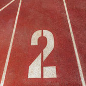 Number 2 on red running track — Stock Photo