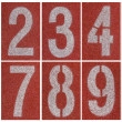 Collection of 0 to 9 ,Numbers on red running track — Stock Photo #48284855
