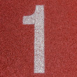 """1"" Numbers on red running track — Stock Photo #48284889"