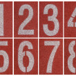 Collection of 1 to 8 ,Numbers on red running track — Stock Photo #48284895