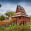 Ancient Tripitaka Hall wooden monastery on the lotus pond at wat Thung Si Muang in Ubon Ratchathani province, Thailand — Stock Photo #51265629