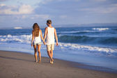 Lovely couple on beach. — Stock Photo