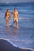 Lovely couple on beach. — Stock Photo