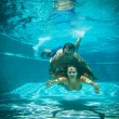 Woman and man under water — Stock Photo