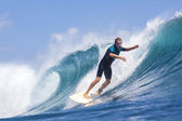 Surfer on waves — Stock Photo