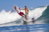 Surfers on waves — Stock Photo