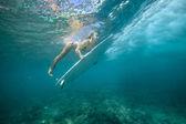 Female surfer underwater — Stock Photo