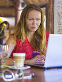 Young woman with computer — Stock Photo