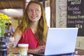 Girl with computer — Stock Photo