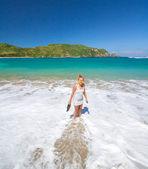 Young woman walking on beach — Stock Photo