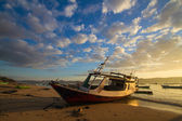Fish boat at sunrise in Asia — Stock Photo