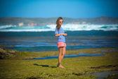 Woman Walks Alone on a Deserted Beach — Stock Photo