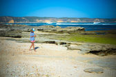 Woman Walks Alone on a Deserted Beach — Stok fotoğraf