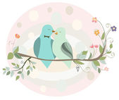 Couple of birds in love on a branch — Stock Vector