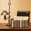 Stock Photo: Boxed books with lamp